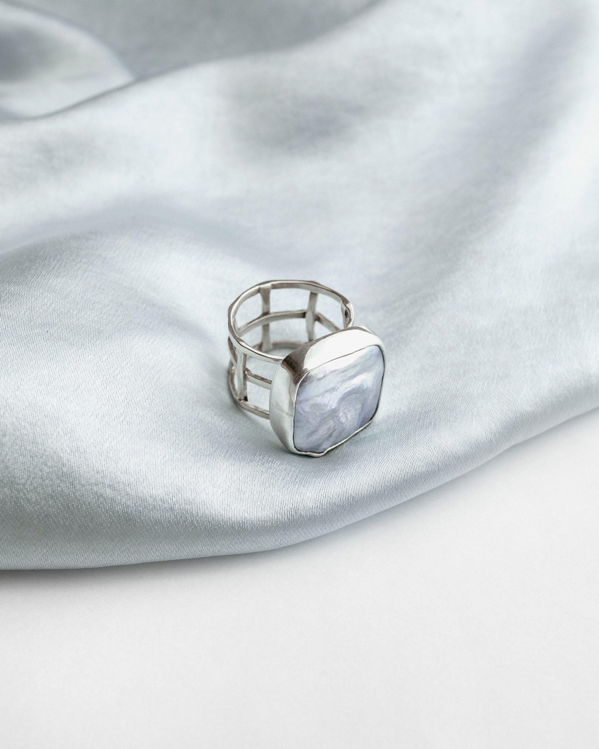 a photo of silver jewelry. photo credit roman shilin unsplash